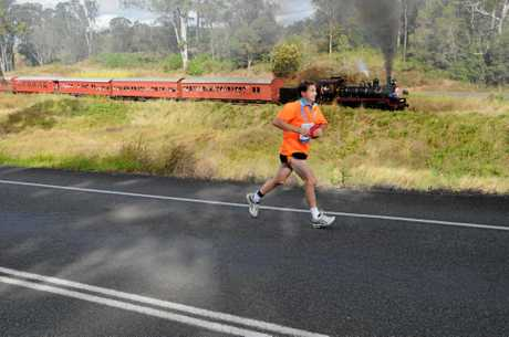 2012 Race the Rattler a runner races the train. Craig Warhurst/The Gympie Times