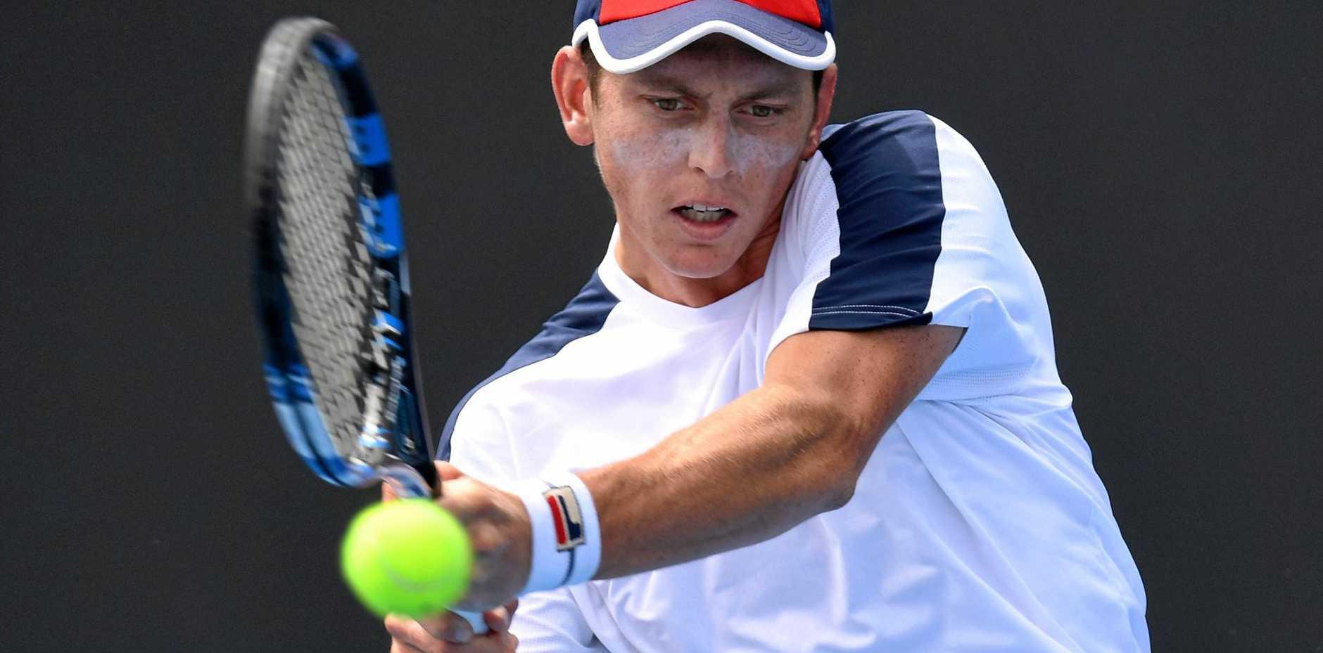 Andrew Whittington of Australia in action against Adam Pavlasek of Czech Republic.