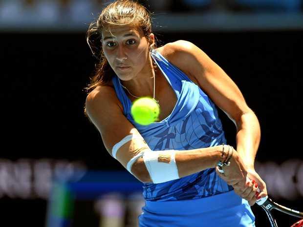 Jaimee Fourlis of Australia in action against Svetlana Kuznetsova of Russia in round two of the women's singles at the Australian Open.