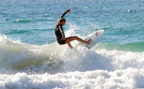 Sasha Baker on her way to winning the under-16 girls title at last week's North District School Surfing Trials at Coolum.