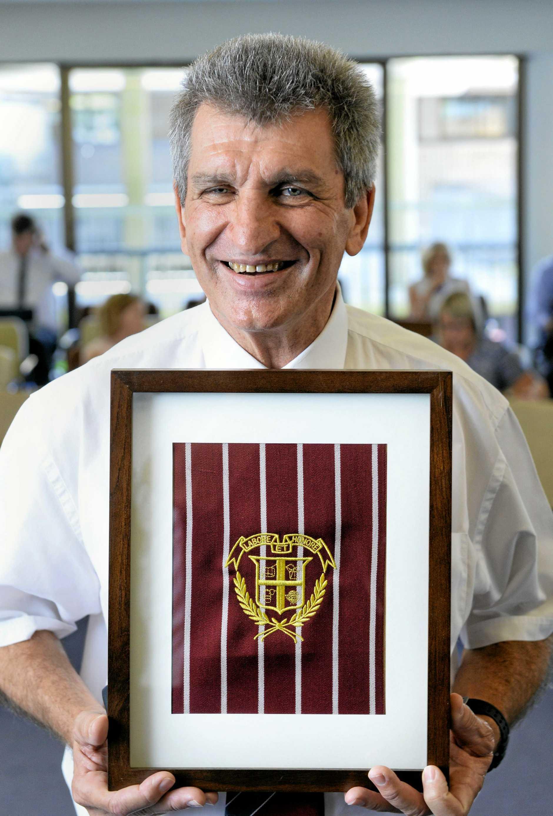 Geoff Dieckmann is retiring from Ipswich Grammar School after 47 years. He was presented with a gold blazer pocket by the school.