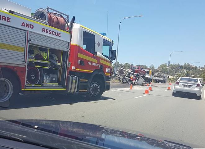 The scene at a truck rollover on the Sunshine Motorway.