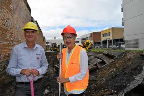 Bennett Constructions managing director Darryl Piper and Lismore mayor Jenny Dowell turning the first sod at the construction site of Bennett's $9 million three level office building.