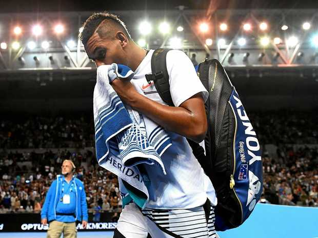 Nick Kyrgios of Australia departs Hisense arena after being defeated by Andreas Seppi of Italy in round 2.