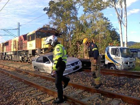 The vehicle allegedly left on a level crossing was pushed about 100m by a freight train.