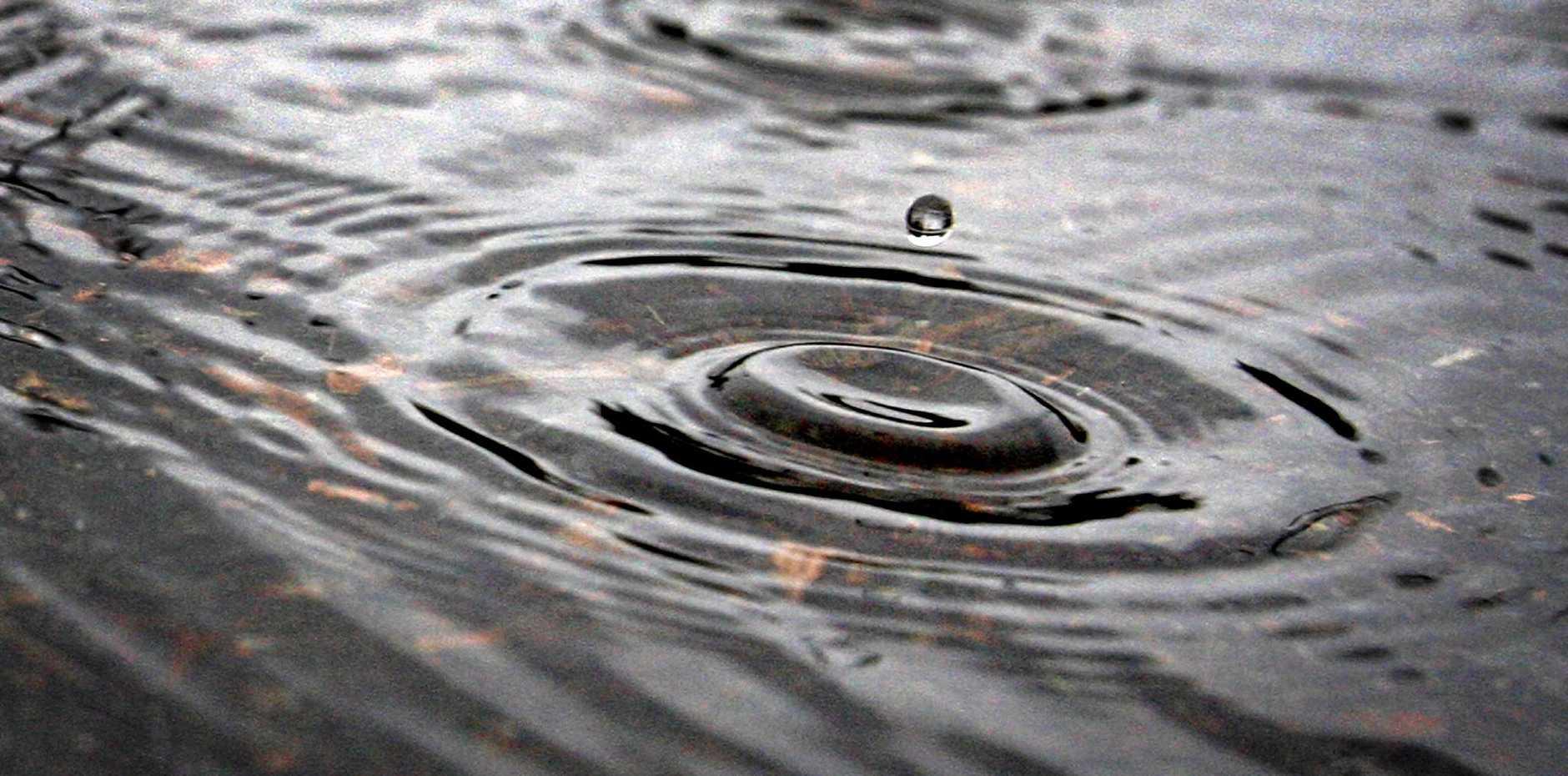 One of billions of Rain Drops falls on the tweed Photo Blainey Woodham / Daily News