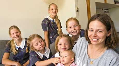 READY FOR SCHOOL: ( back from left ) Katelyn, 14, Susan, 12, Melody, 10, ( Front from left ) twins Philippa and Victoria, 6, and 13-week-old Amy with mum Joy McHugh. Wednesday Jan 18, 2017.