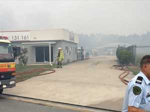 Firefighters protect gas depot from raging bushfire