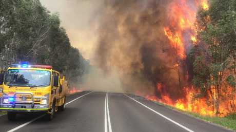 BUSHFIRE: The blaze burns out of control along the Sunshine Mwy at Coolum Beach.