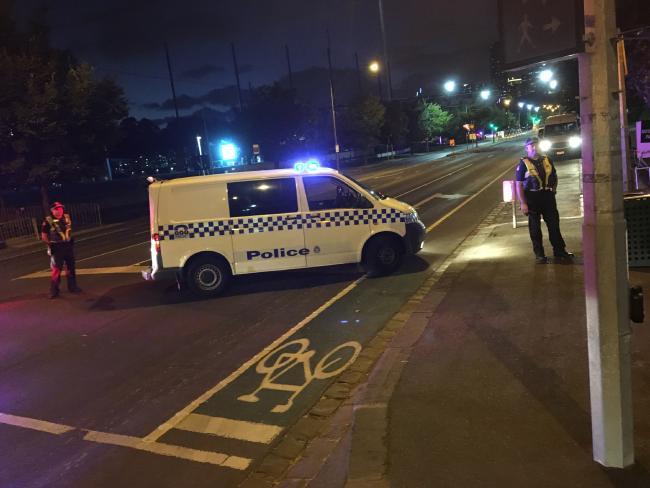 Police man the roadblock outside Melbourne Park.