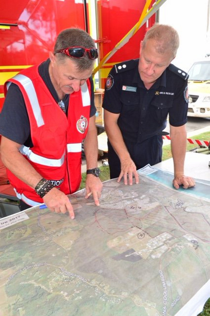 Firefighters consult the map of the fire ground.