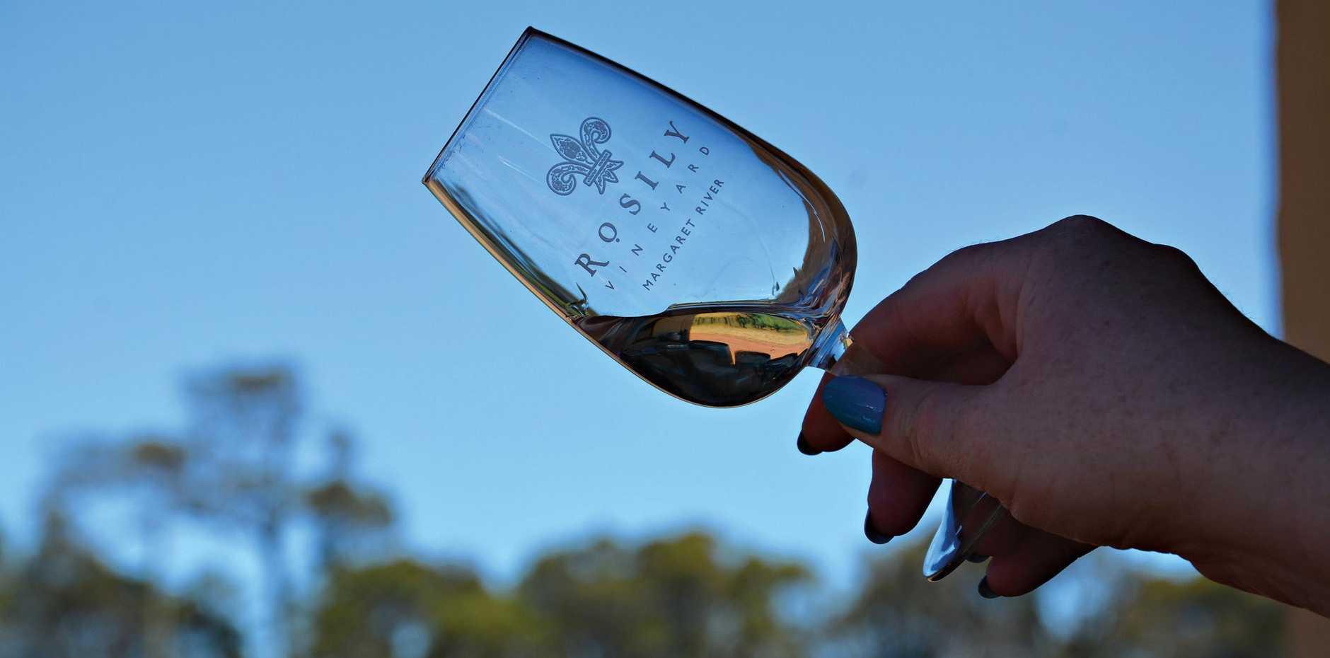 Tasting wine at Rosily winery in the Margaret River region in Western Australia.