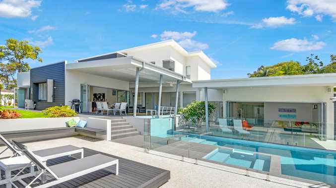 Retreat with tennis court pool 10 car garage could be for Garages you can live in