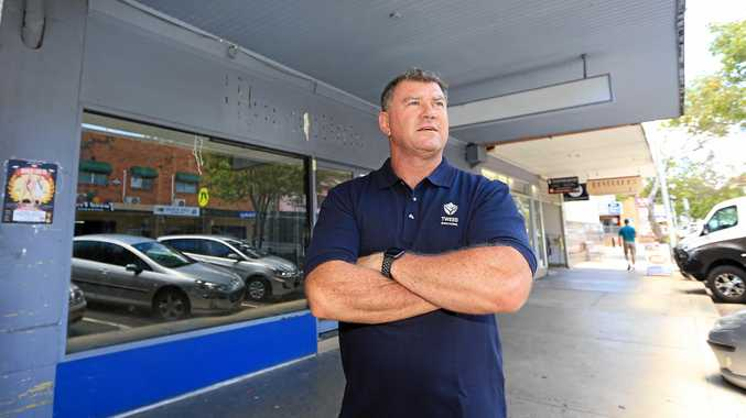 Tweed Shire Councillor Pryce Allsop in front of one of 12 empty shop fronts in the main street of Murwillumbah.