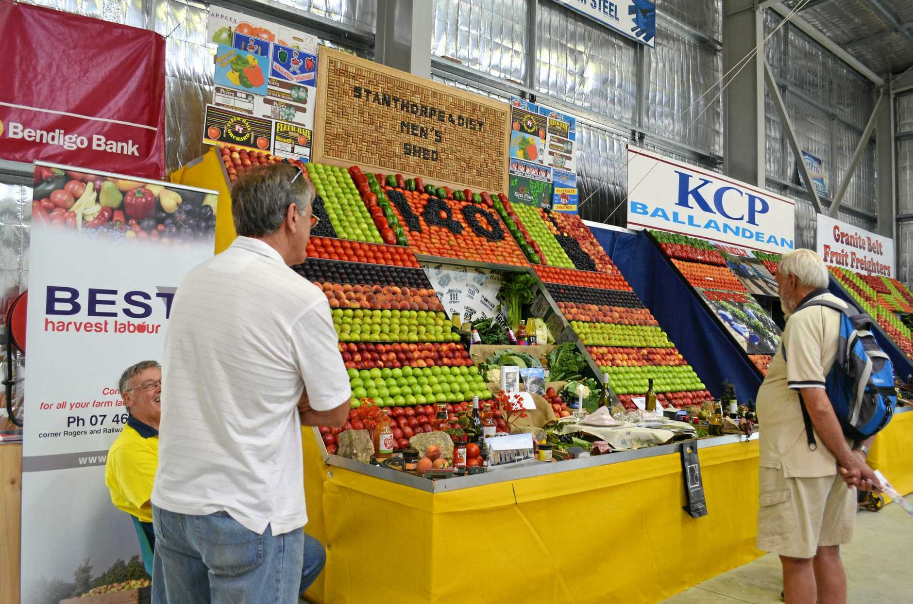 Guests admiring the fruit and veg wall displays at the JJ Richards and Sons 2016 Stanthorpe Show.