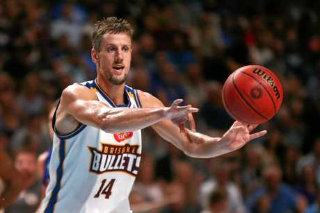 Daniel Kickert of the Brisbane Bullets passes the ball at Titanium Security Arena