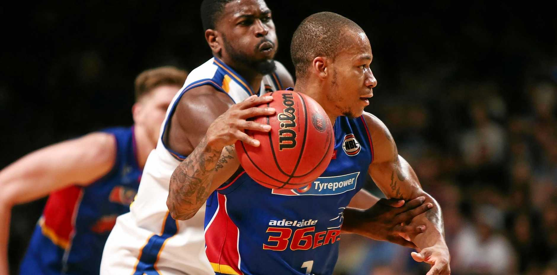 Jerome Randle of the Adelaide 36ers gets away from Jermaine Beal of the Brisbane Bullets
