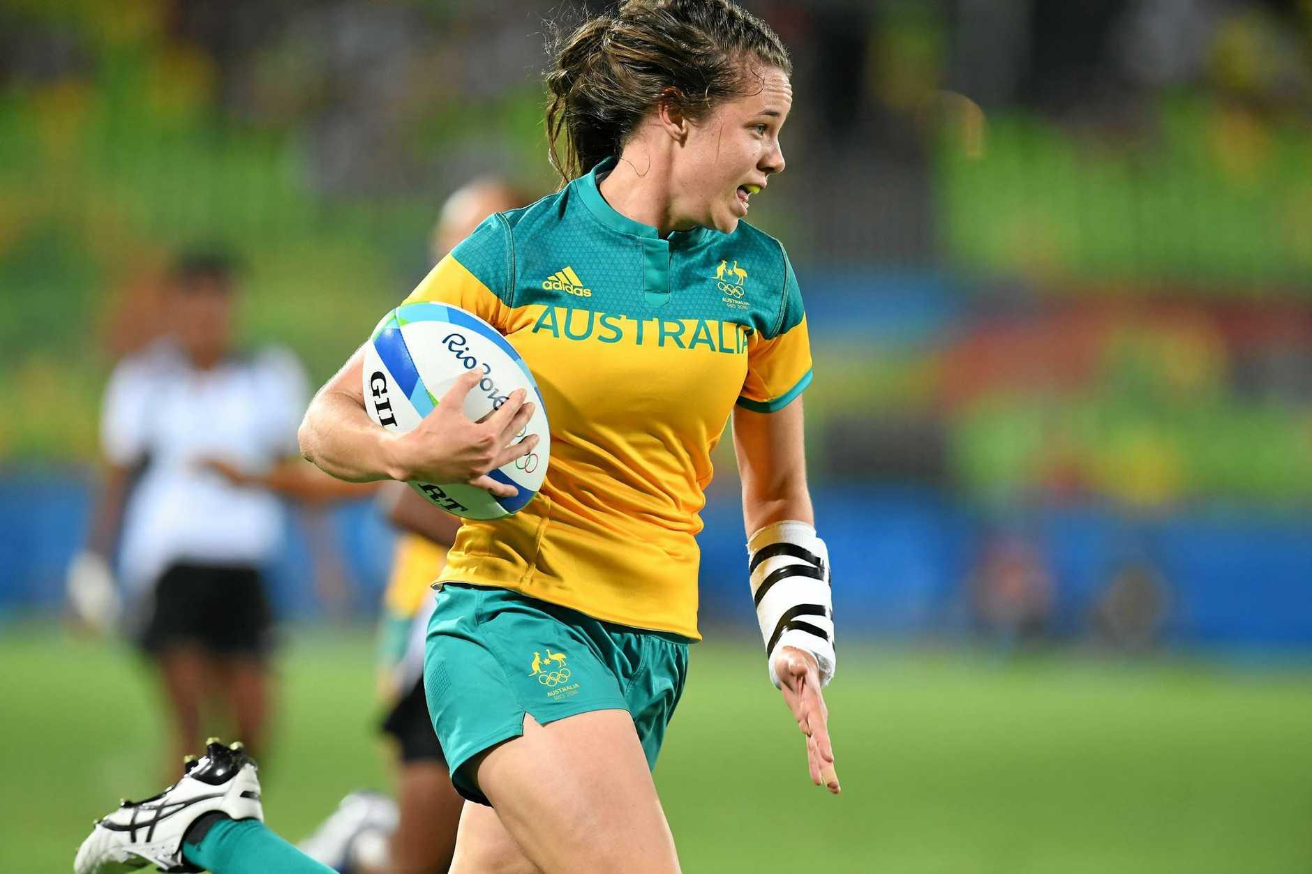 Australia's Chloe Dalton runs into score at the Rio Olympics.