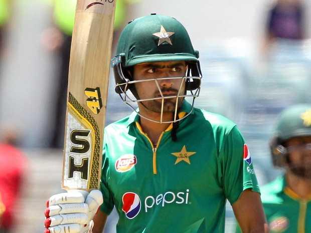 Babar Azam of Pakistan raises his bat after reaching 50 runs during the third ODI against Australia.
