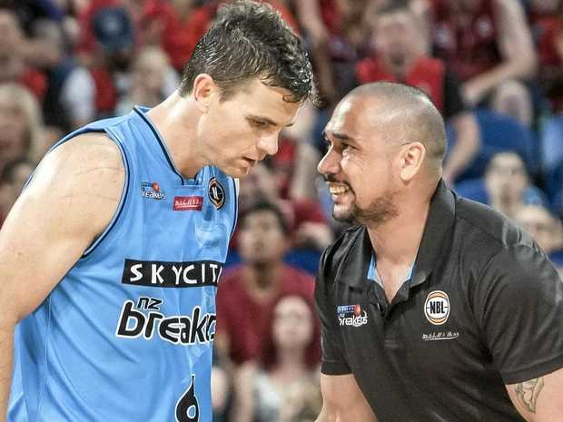Breakers coach Paul Henare talks to his star man Kirk Penney.