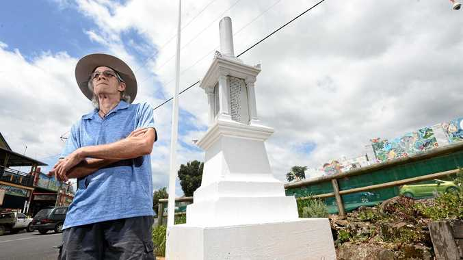 FRUSTRATED: Nimbin District Memorial caretaker Paul Le Bars is disappointed someone would go to the trouble of decapitating flowers around the memorial.