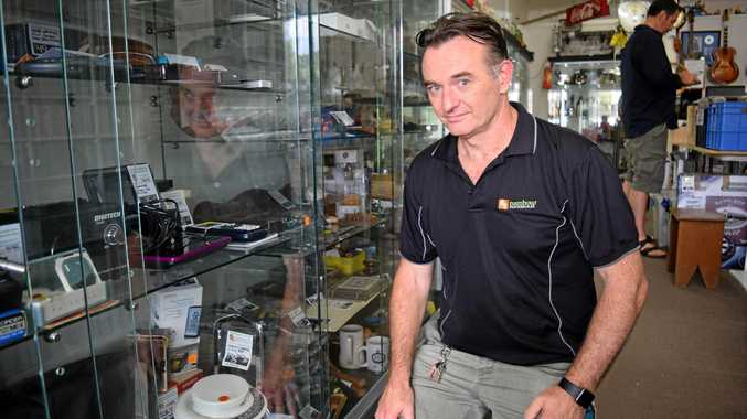 BRAZEN: Nambour Pawnbroker and Secondhand manager Richard Grenfell says he will improve security on his glass cabinets after this week's brazen iPad theft.