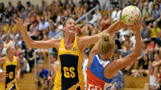ALL ABOUT THAT BASS: Sunshine Coast Lightning's Caitlin Bassett fights for the ball against NSW Swifts last weekend.