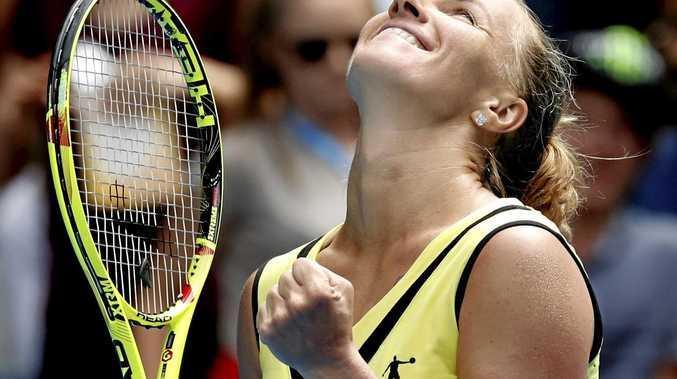 Russia's Svetlana Kuznetsova celebrates after defeating Serbia's Jelena Jankovic.