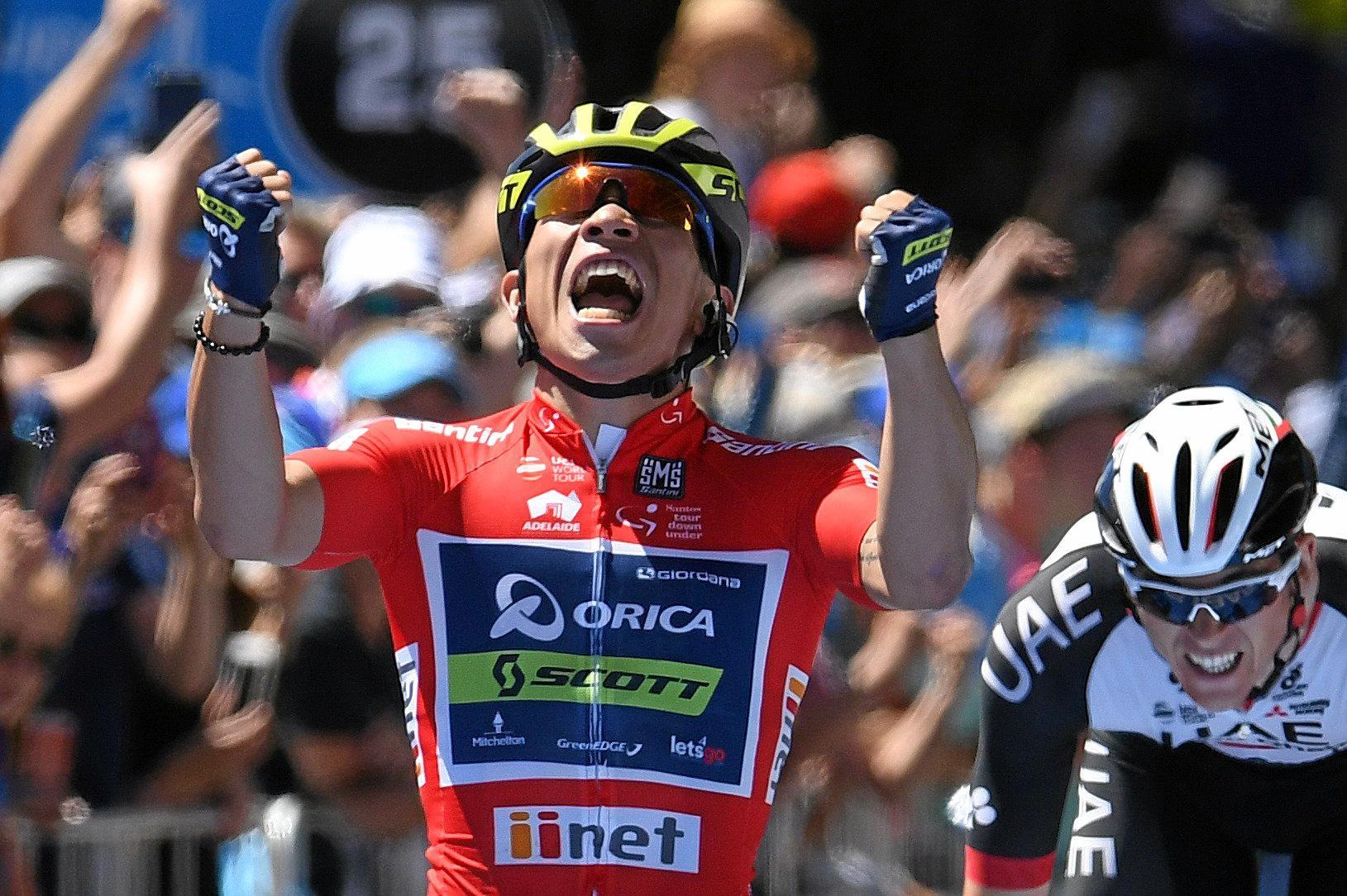 Australian rider Caleb Ewan of team Orica-Scott (centre) celebrates winning stage four of the Tour Down Under in Campbelltown near Adelaide.