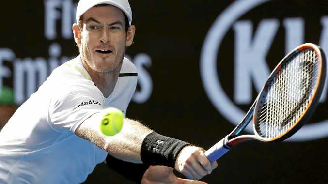 Britain's Sir Andy Murray makes a backhand return to Sam Querrey of the USA during their third-round match at the Australian Open.