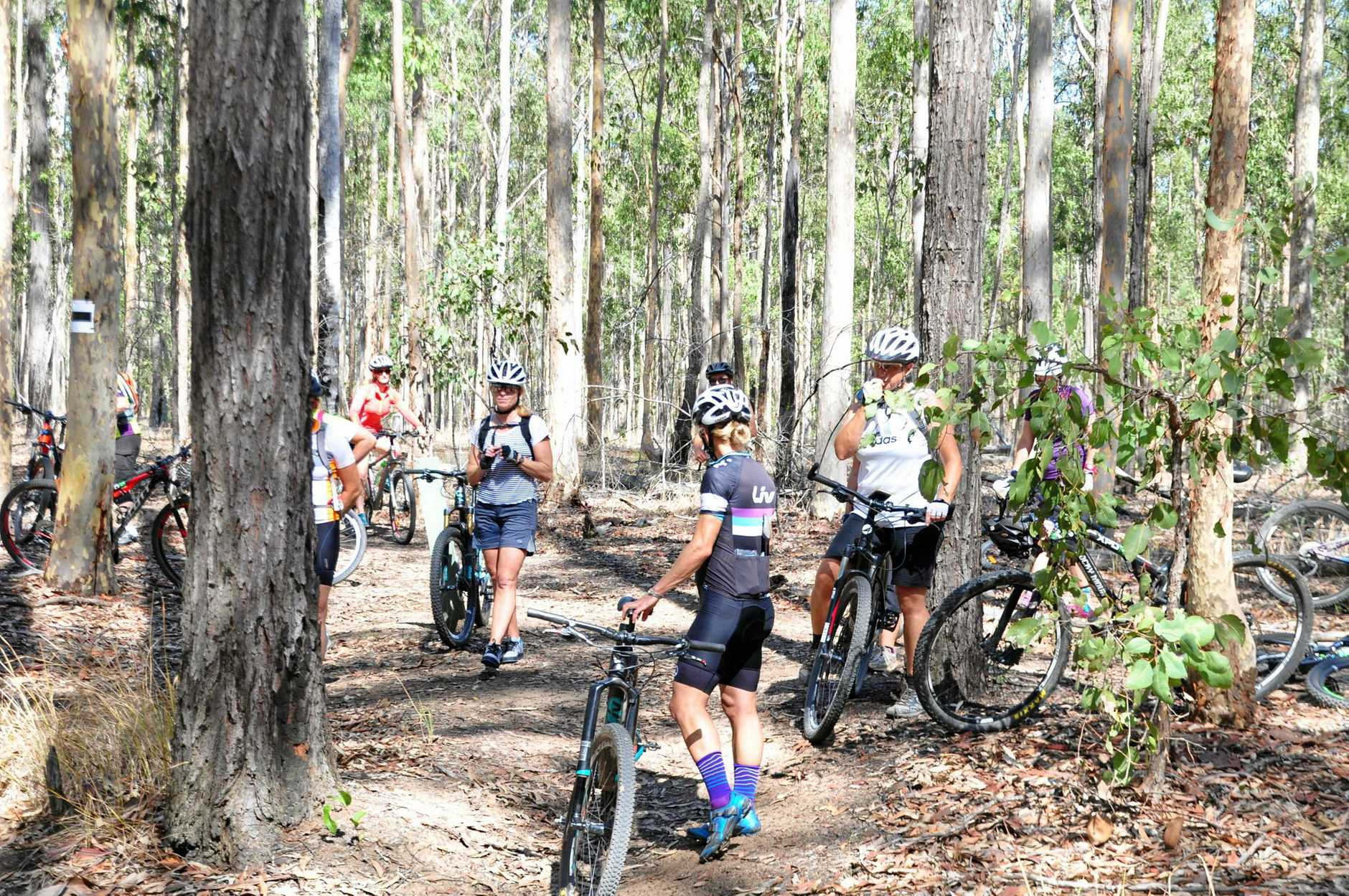 MTBA coach Jodie Willett gives her group a few lessons before setting off during the Mountain Bikking Australia women's skills session at Bom Bom State Forest.