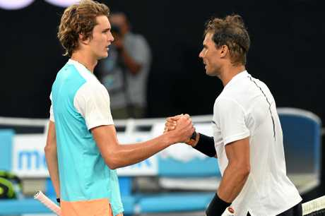 Rafael Nadal of Spain (right) is congratulated on his win after the match against Alexander Zverev of Germany (left)