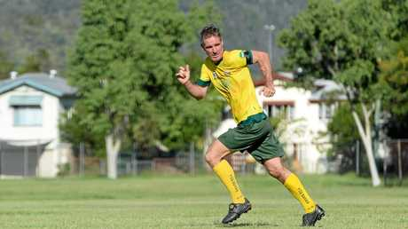 CELEBRATION: Blair Grice takes to the field during the memorial soccer game in memory of his wife Angela.