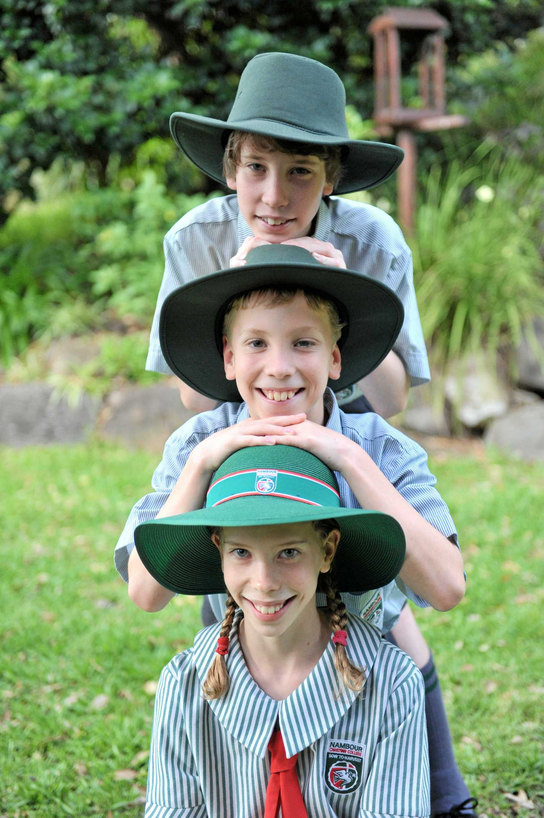 TAKE TWO, OR THREE: Matt, Tayla and Riley Clegg are now 12 and will attend Nambour Christian College on Monday. Photo: John McCutcheon / Sunshine Coast Daily.