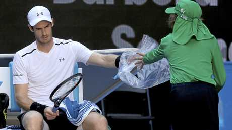 Britain's Andy Murray changes his racket while playing Germany's Mischa Zverev
