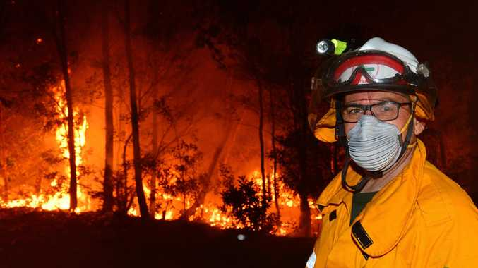 CONCERN BUT NO PANIC: A huge bushfire impacts Peregian Springs and Coolum residents as the flames threaten their homes. The fire burnt over 500 hectares and dozens of emergency crews were deployed throughout the night. Firemen battle the heat and the bleze.