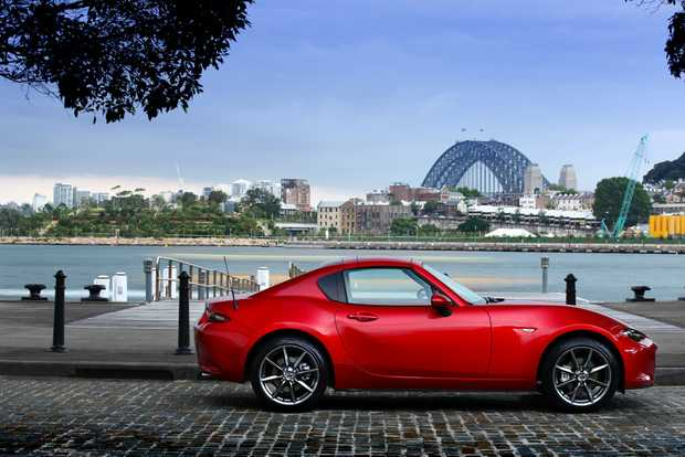 The Mazda MX-5 RF has an electrically operated hard-top retractable roof, adding broader appeal to those seeking open-top small sports car motoring. It starts from $38,550 before on-roads.