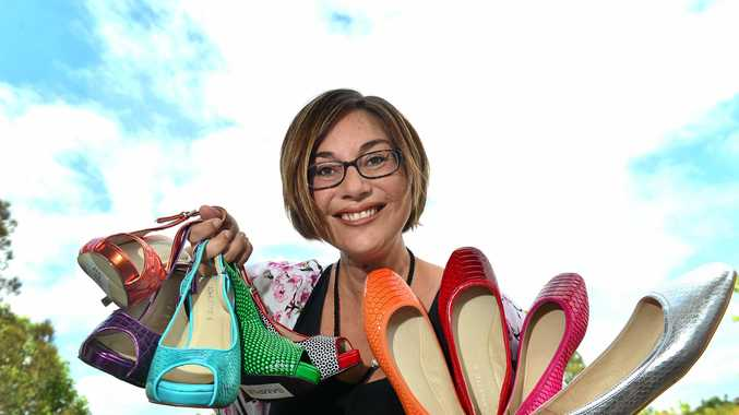 COLOUR: Candice Bernadoni of Scarletto's with some of her colourful shoes.