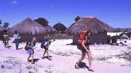 OFF THE BEATEN TRACK: Trish Clark, Zara and Sean take a shortcut through a local village to the TanZam Railway (Tanzania) while backpacking through Africa in 1976.