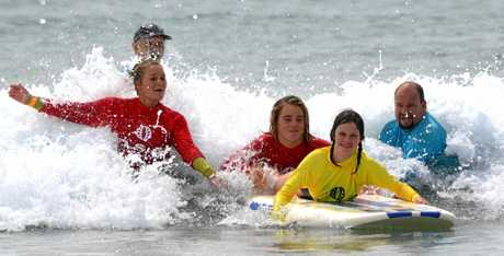 A participant catches a wave.