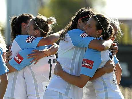 Rebekah Stott of Melbourne City celebrates with teammates after scoring a goal
