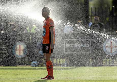 MELBOURNE, AUSTRALIA - JANUARY 22:  Nina Frausing-Pederson of Brisbane Roar stands under a sprinkler after it was switched on during the round 13 W-League match between Melbourne City and Brisbane Roar at C.B. Smith Reserve on January 22, 2017 in Melbourne, Australia.  (Photo by Robert Cianflone/Getty Images)