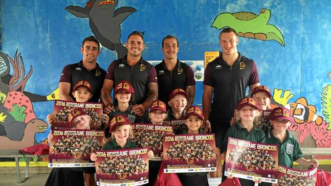 The Broncos players visiting Warra State School during the 2016 Surat Basin school tour.