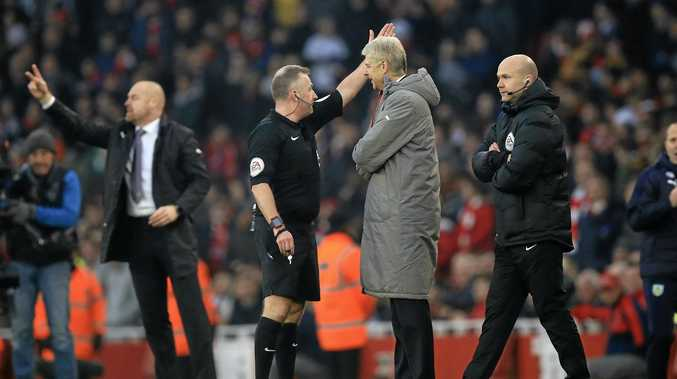 OFF YOU GO: Referee Jonathan Moss sends Arsenal manager Arsene Wenger after a clash with the fourth official.