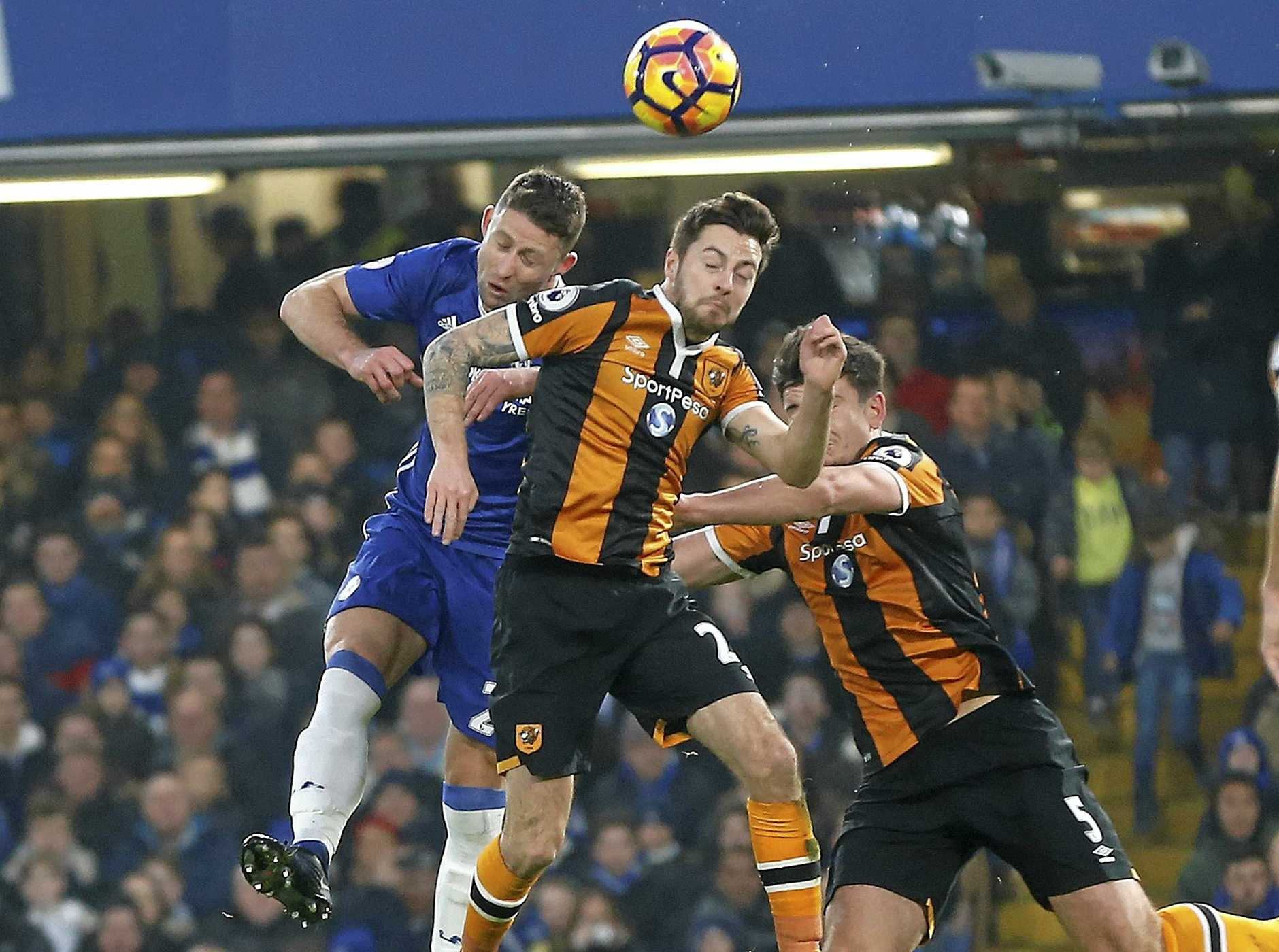 SKULL FRACTURE: Hull City's Ryan Mason (centre) suffered a sickening injury after a collision with Chelsea's Gary Cahill (left).
