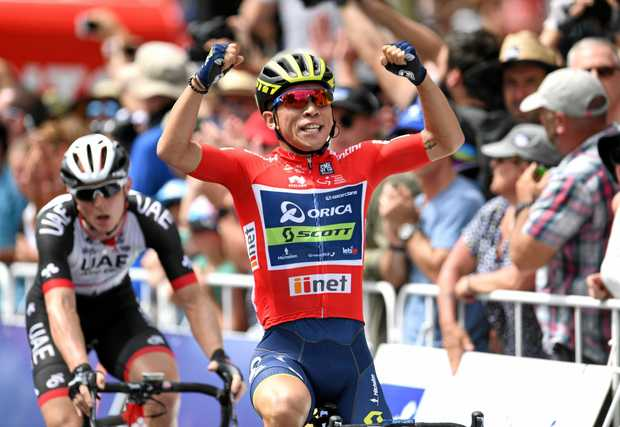 Caleb Ewan, of team Orica-Scott, celebrates winning stage six of the Tour Down Under in Adelaide.