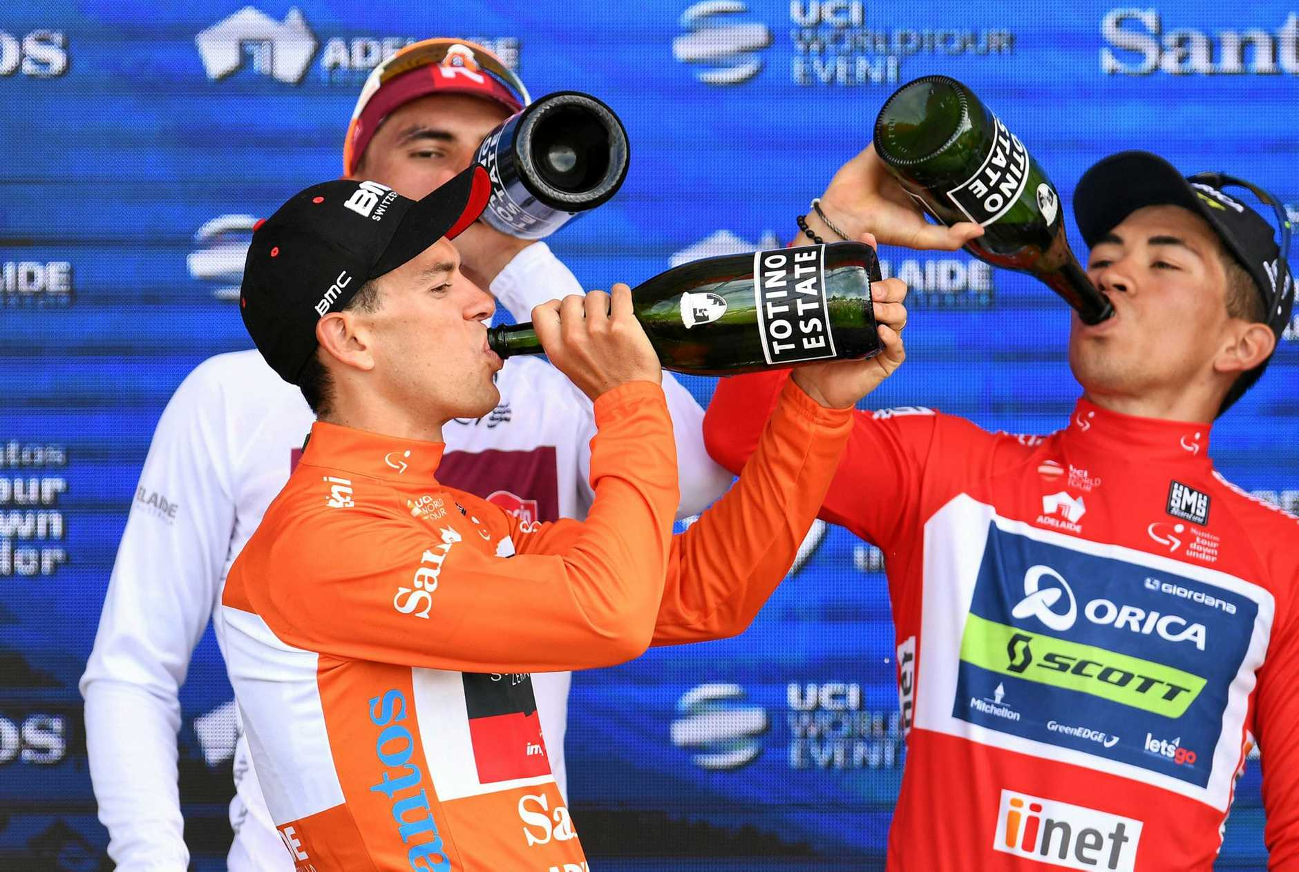 Australian Richie Porte, of team BMC Racing (front), along with Caleb Ewan (right) and Jhonatan Restrepo drink a celebratory champagne at the winners presentation.