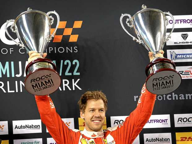 SOLO EFFORT: German Sebastian Vettel celebrates his victory after winning the America vs the World Race of Champions Nations Cup in Miami. Vettel raced alone after team-mate Pascal Wehrlein withdrew