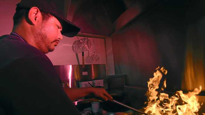 COOKING BONANZA: Thai on Carrington co-owner Pisan Wongkruth cooks up a storm at the new Thai restaurant.