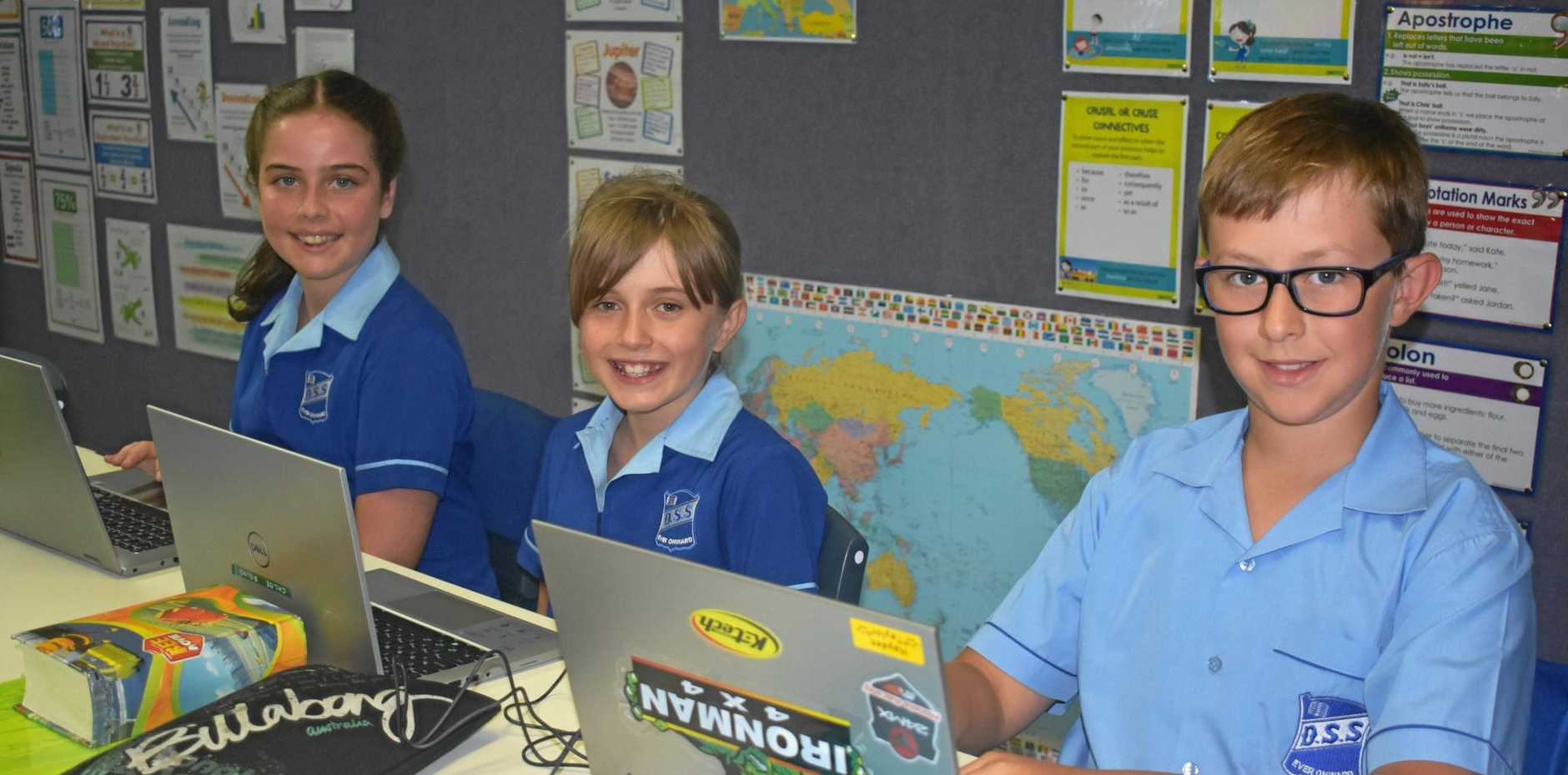 BACK TO SCHOOL: Dalby State School vice captains Hayden Taylor, Chloe Bound and Abbey Burton on their new laptops.